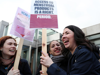 Scottish Parliament member Monica Lennon (right) joins supporters of the Period Products bill she sponsored, at a rally outside Parliament in Edinburgh on Tuesday. The legislation would make Scotland the first country in the world to make products like pads and tampons freely available.