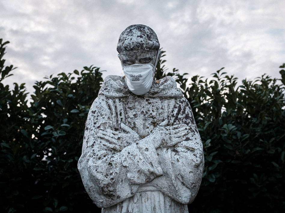 A face mask adorns a statue of St. Francis of Assisi in the town of San Fiorano, one of the places in Italy on lockdown due to the novel coronavirus outbreak. The picture was taken by schoolteacher Marzio Toniolo. (Marzio Toniolo/via Reuters)