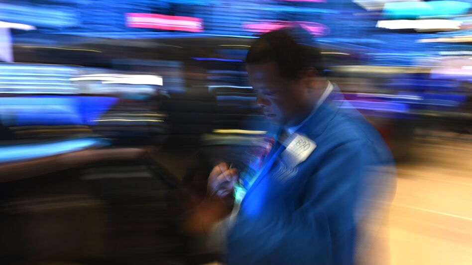 Traders work during the opening bell at the New York Stock Exchange on Friday. Losses on Wall Street deepened following a bruising open, as global markets were poised to conclude their worst week since 2008 with another rout. (Johannes Eisele/AFP via Getty Images)