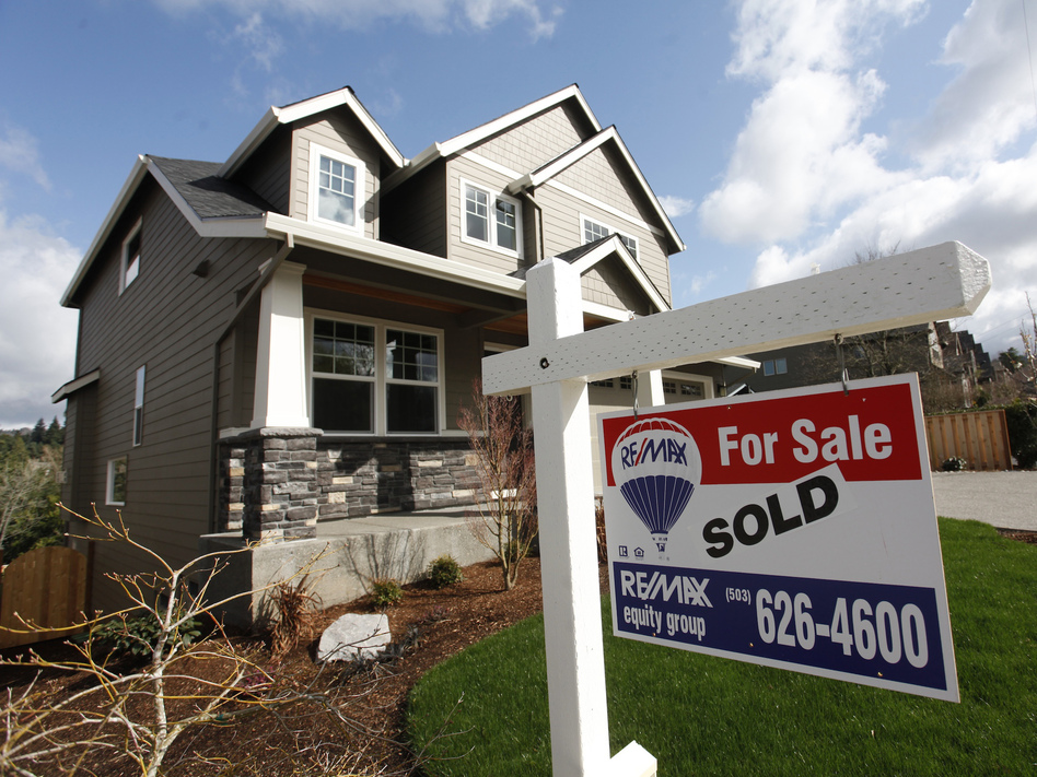 Coronavirus fears sent stock markets plummeting last week, but they're also pushing mortgage rates down near historical lows. That's an opportunity for homebuyers and homeowners. (Steve Dipaola/Reuters)