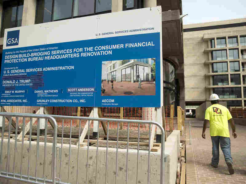 A sign stands at the construction site for the Consumer Financial Protection Bureau's new headquarters in Washington
