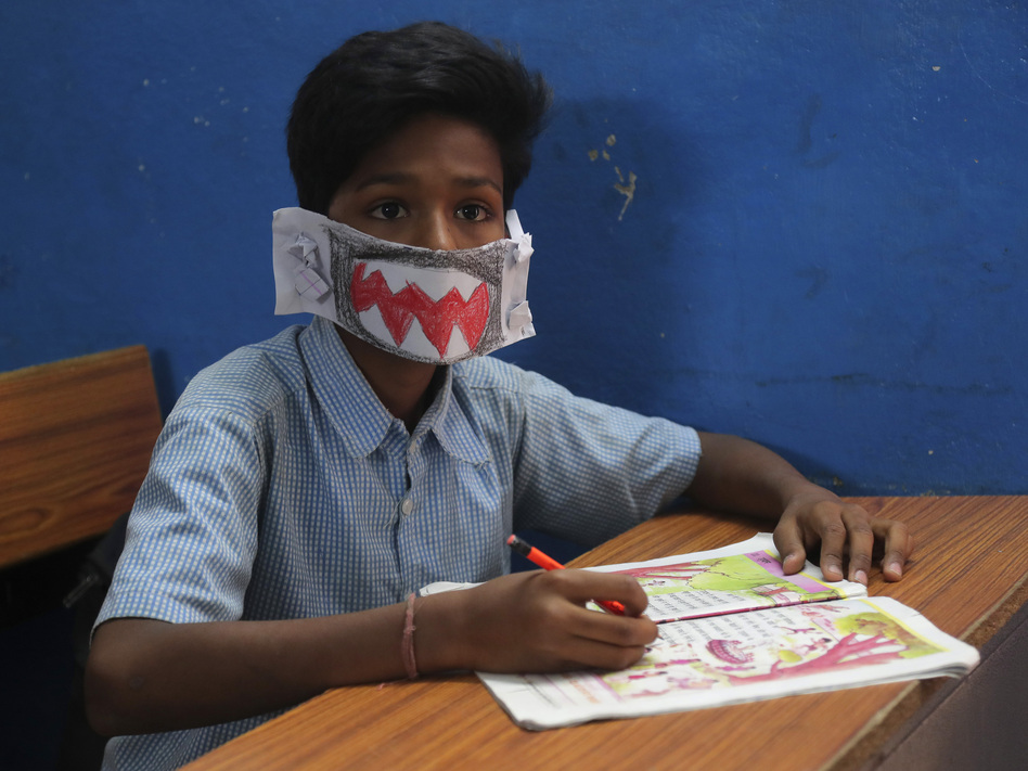 An Indian student wears a self-made mask during class in Hyderabad, India, on Wednesday. The country has reported at least 29 cases of the virus. (Mahesh Kumar A./AP)
