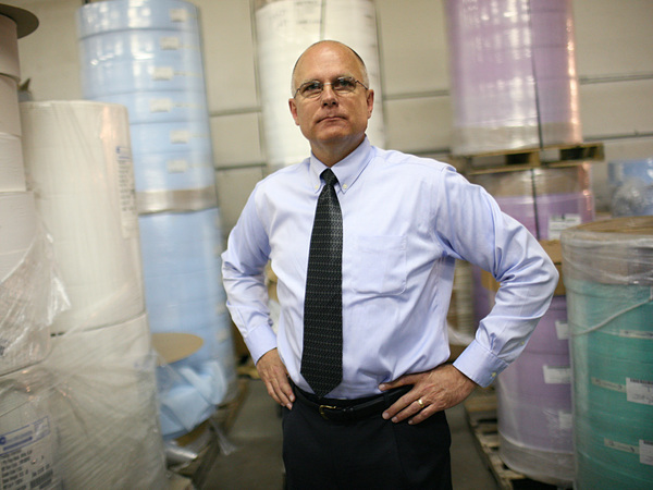 Prestige Ameritech Executive Vice President Mike Bowen, pictured in 2009, says his company can't keep up with demand for face masks used by doctors and nurses amid the coronavirus outbreak.