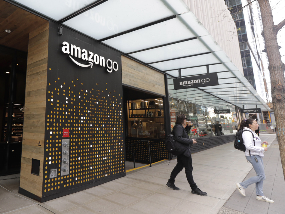 Amazon is among the companies telling workers in the Seattle area to stay home as the coronavirus outbreak spreads. (Ted S. Warren/AP)