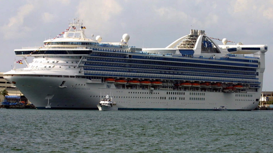 At least 100 people aboard the Grand Princess cruise ship will be tested for the coronavirus that causes COVID-19 after a former passenger died from the disease this week. The ship is seen here in a photo from 2001. (Luis M. Alvarez /AP)