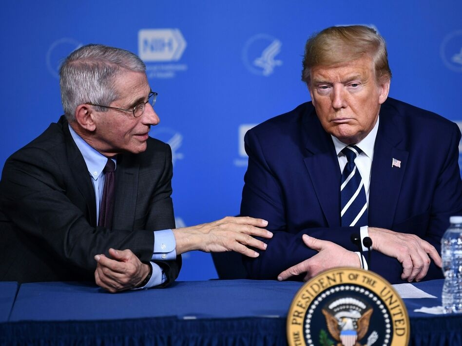 President Trump listens to Anthony Fauci, director of the NIH National Institute of Allergy and Infectious Diseases, after a tour earlier this week. (Brendan Smialowski/AFP via Getty Images)