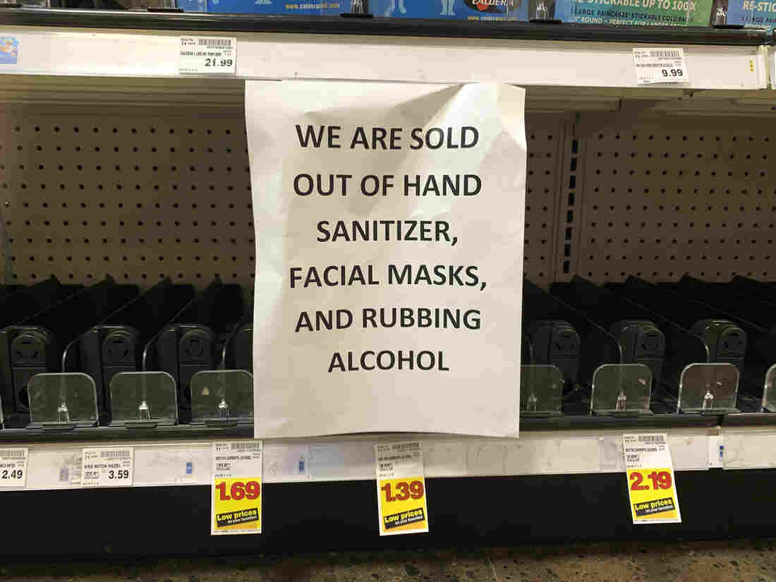 A sign advising out-of-stock sanitizer, facial masks and rubbing alcohol is seen at a store following warnings about COVID-19 in Kirkland, Washington on March 5, 2020.