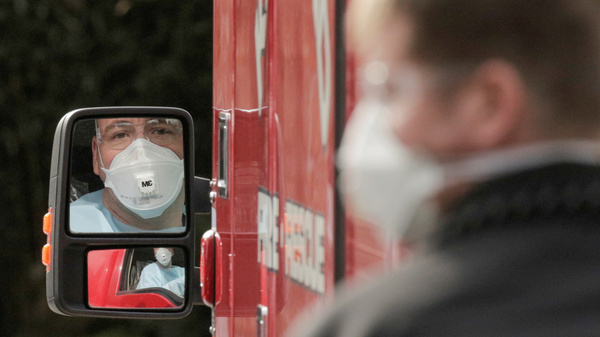 A medic drives an ambulance at the Life Care Center of Kirkland, Wash, which has been linked to most of the COVID-19 deaths in the U.S. so far.