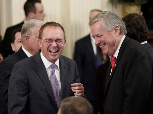 Mick Mulvaney, then the acting White House chief of staff, laughs with Rep. Mark Meadows (R-NC) a month ago at an event celebrating President Trump's acquittal on two articles of impeachment.