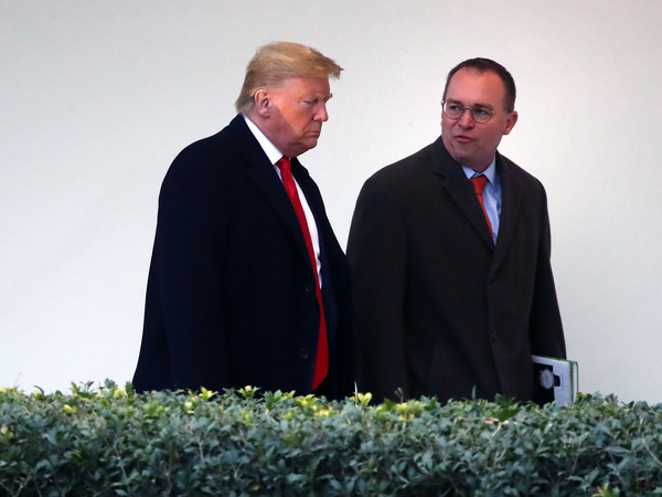 Trump and Mulvaney walks along the West Wing Colonnade in January.