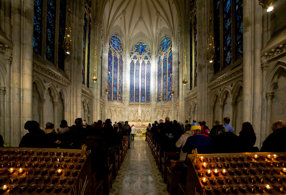 Catholic worshipers attend Mass at Saint Patrick's Cathedral in New York City. Celebrating Holy Communion without shared wine is fine, in the age of COVID-19, many churches have decided. (Artem Vorobiev/Getty Images)