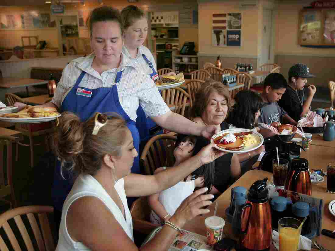 ELGIN, IL - JULY 16: Waitresses Gretchen Boren (L) and Michelle Enright wait on customers at an IHOP restaurant July 16, 2007 in Elgin, Illinois. (Photo by Scott Olson/Getty Images)