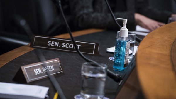 A bottle of hand sanitizer is seen during a Senate Homeland Security Committee hearing on Capitol Hill Thursday. Lawmakers are preparing to what to do if coronavirus hits the Capitol.