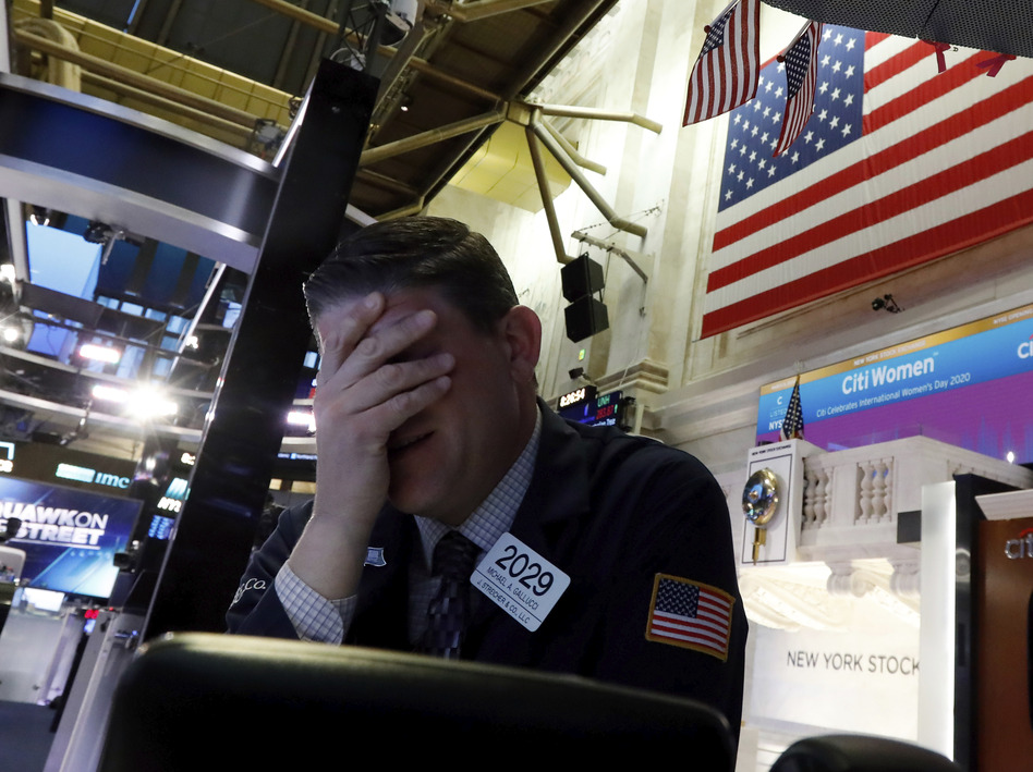 A trader reacts on the floor of the New York Stock Exchange on Monday. The U.S. stock market had its worst day since 2008. (Richard Drew/AP)