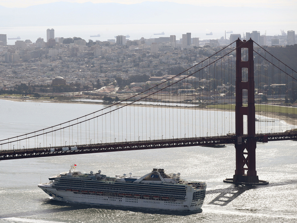 The Grand Princess cruise ship heads under the Golden Gate Bridge to a port in Oakland, Calif., on Monday. The ship's more than 2,400 passengers are headed to either medical care or a quarantine due to the coronavirus. (Ezra Shaw/Getty Images)