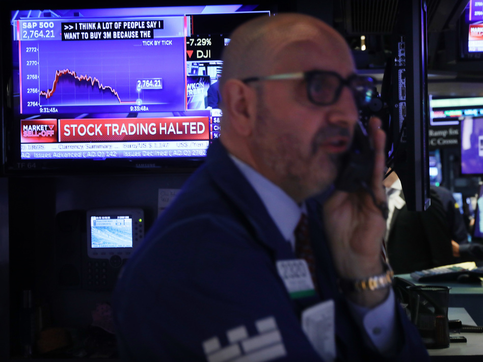 Trading on the New York Stock Exchange was halted briefly Monday morning when the S&P 500 index fell 7%, triggering automatic circuit breakers. (Spencer Platt/Getty Images)