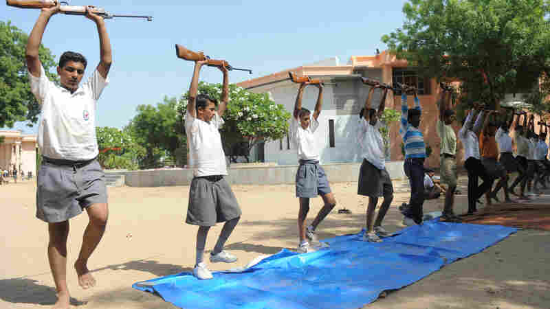 An air rifle training session at an RSS youth camp on the outskirts of Ahmedabad. Youth camps like these draw on the ideology of Hindutva and emphasize military discipline and Hindu scripture.