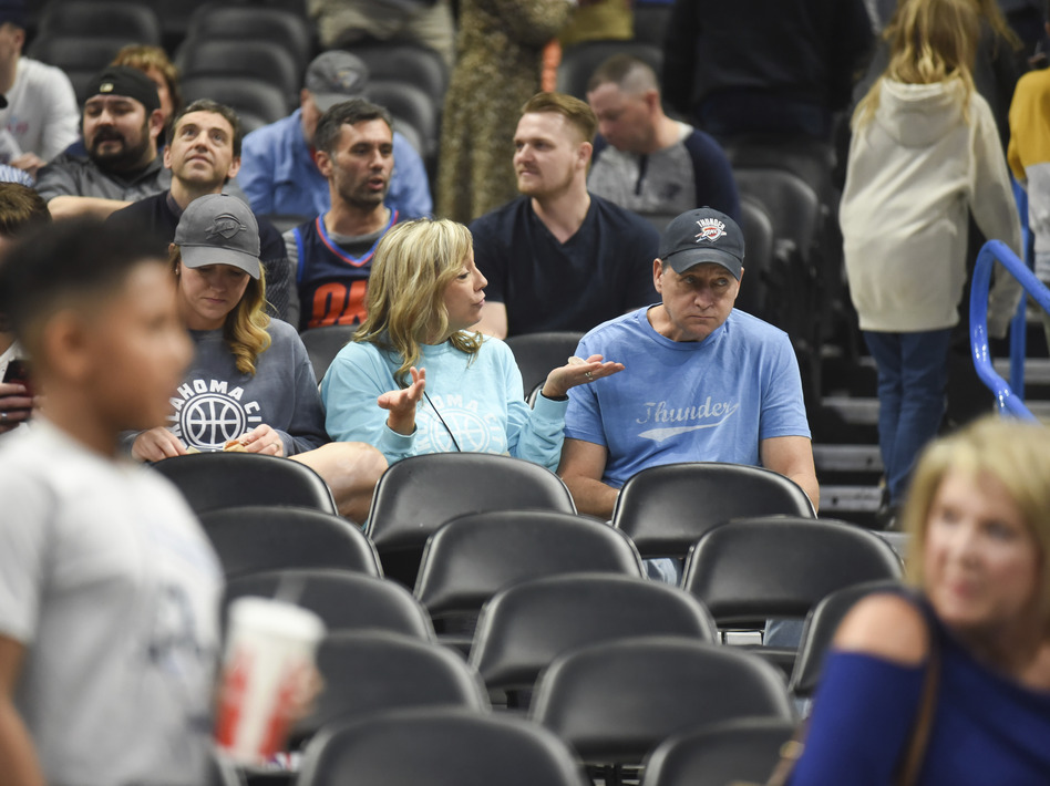Basketball fans react after it is announced that an NBA basketball game between Oklahoma City Thunder and Utah Jazz in Oklahoma City has been postponed on Wednesday, March 11. (Kyle Phillips/AP)