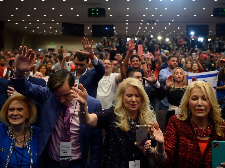 "Supporters pray as President Donald Trump speaks during an ""Evangelicals for Trump"" campaign event held at the King Jesus International Ministry on Jan. 03, 2020 in Miami. (Jim Watson/AFP via Getty Images)"