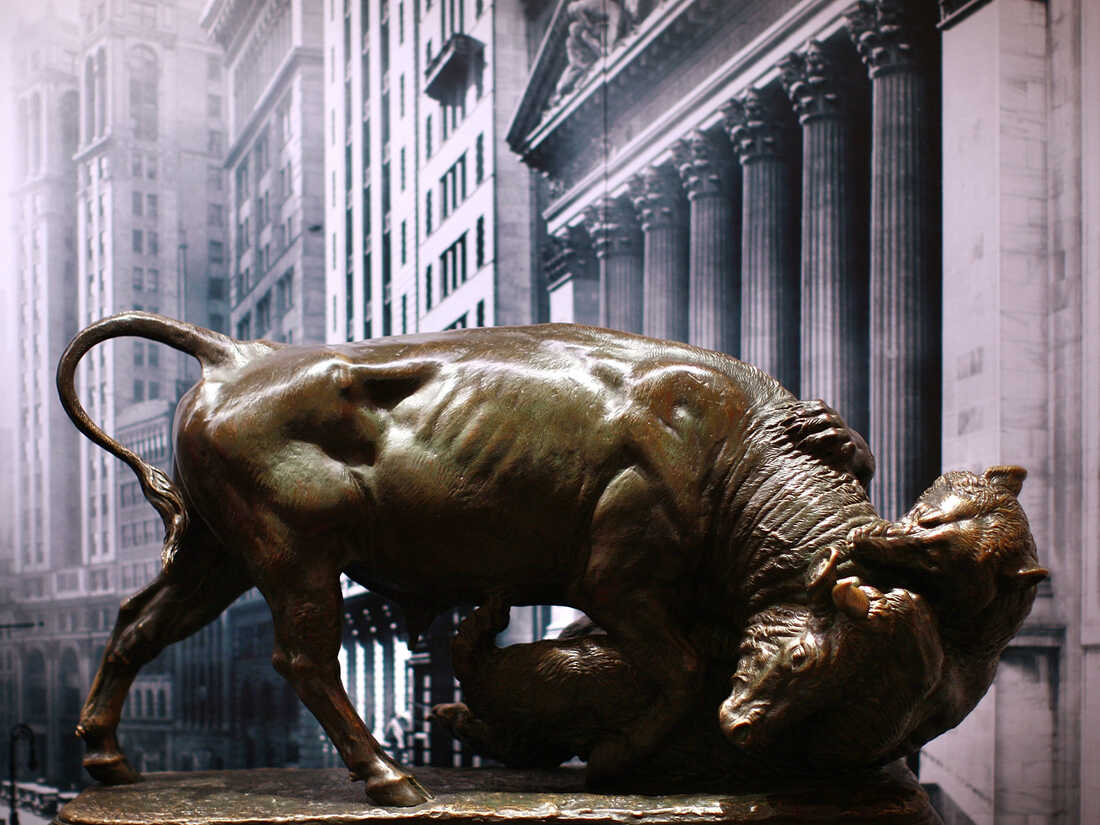 A bronze statue of a bull fighting with a bear.