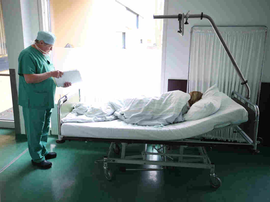PRENZLAU, GERMANY - APRIL 03: Doctor Janusz Rudzinski checks the documents of a young woman from Poland awaking from anesthesia after she underwent an ab. (Photo by Sean Gallup/Getty Images)