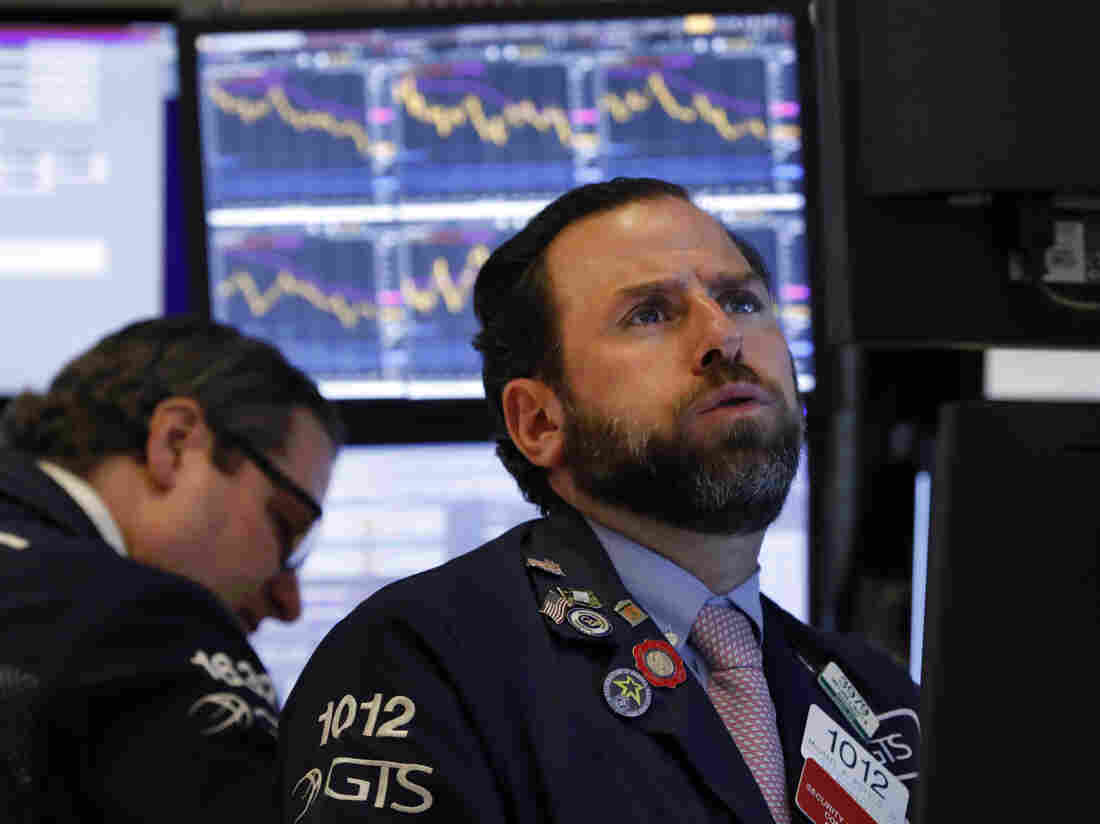 Stock futures sink after rate cut, new virus restrictions