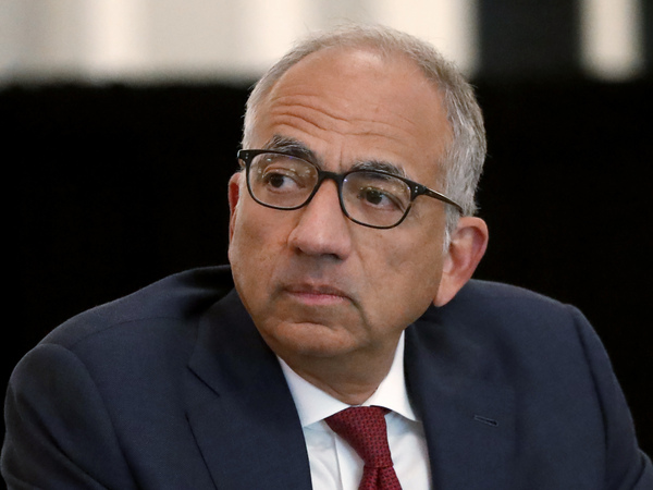 U.S. Soccer President Carlos Cordeiro presides over a meeting of the U.S. Soccer Board of Directors in Chicago in December. Cordeiro resigned Thursday night, three days after the organization filed legal papers in a gender discrimination lawsuit claiming female players had less physical ability and responsibility than men.