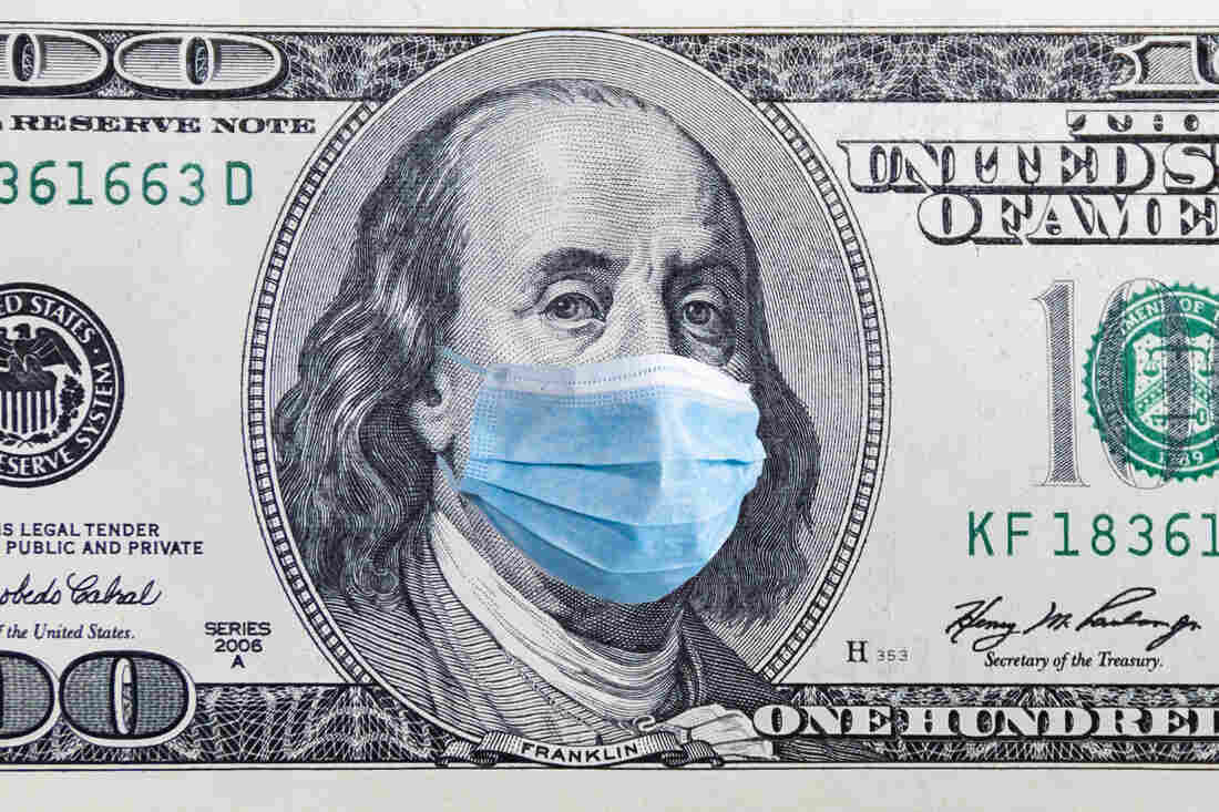 US quarantine, 100 dollar banknote with medical mask.