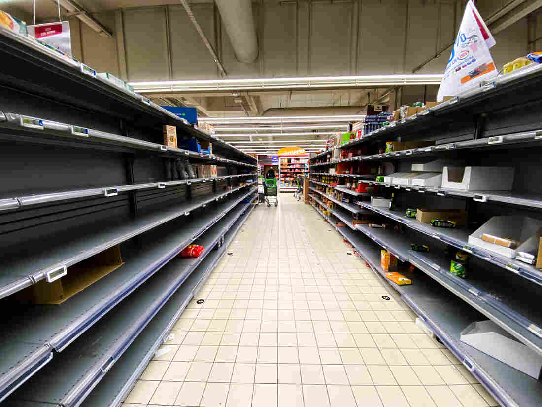 PARIS, FRANCE - MARCH 13: General view of empty shelves in a supermarket, as people have been bulk buying due to the Coronavirus COVID-19 outbreak, on March 13, 2020 in Paris, France.