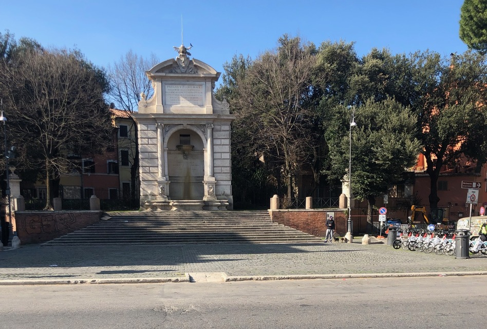 In normal times the pubs and cafes of Piazza Trilussa are the heart of Roman nightlife. Now all is shuttered; the rental bike stand is full and the only sound is the waterfall in the fountain. (Sylvia Poggioli/NPR)
