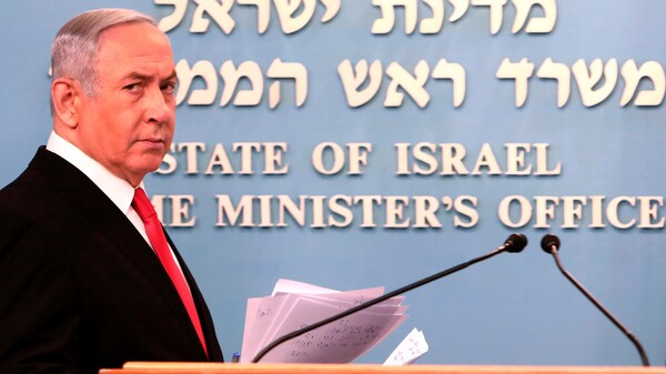 Prime Minister Benjamin Netanyahu approaches the podium to give a speech from his Jerusalem office on Saturday, saying Israel