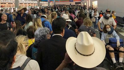 Travelers Greeted With Hours-Long Airport Lines As Coronavirus Screenings Begin