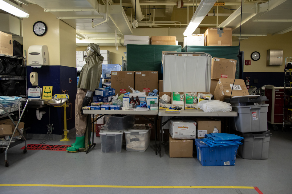 "MedStar Washington Hospital Center's ""ready room"" in Washington, D.C., has mostly been used to house emergency supplies — but some storage carts have been moved out to make way for patient assessment stations. (Ryan Kellman/NPR)"