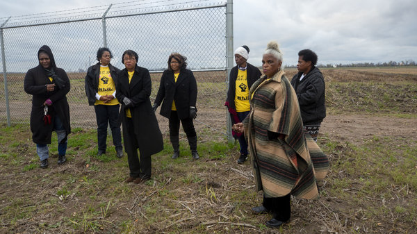 Sharon Lavigne and other members of Rise St. James, who oppose a recently approved chemical complex. They stand on its site, where archaeologists have discovered the graves of former slaves.