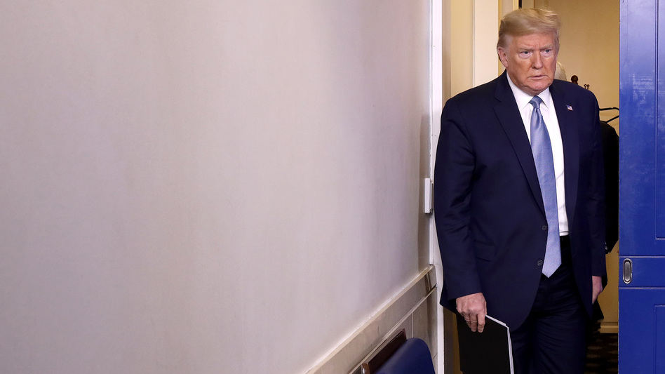 President Trump arrives in the press briefing room to speak about the coronavirus at the White House on Monday. (Win McNamee/Getty Images)