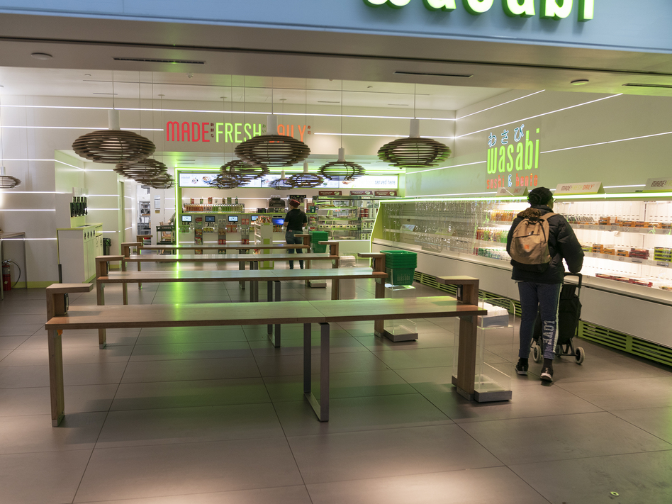 A shopper roams the Wasabi Store in Penn Station in New York on Monday. Food businesses are being urged to serve only take-out orders to reduce the spread of the novel coronavirus. (Lev Radin/Pacific Press/LightRocket via Getty Images)