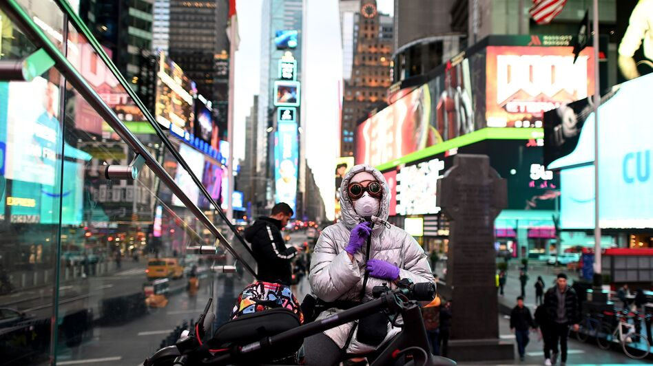 A woman in Times Square in New York wears a face mask against the coronavirus on Tuesday. (Johannes Eisele/AFP via Getty Images)
