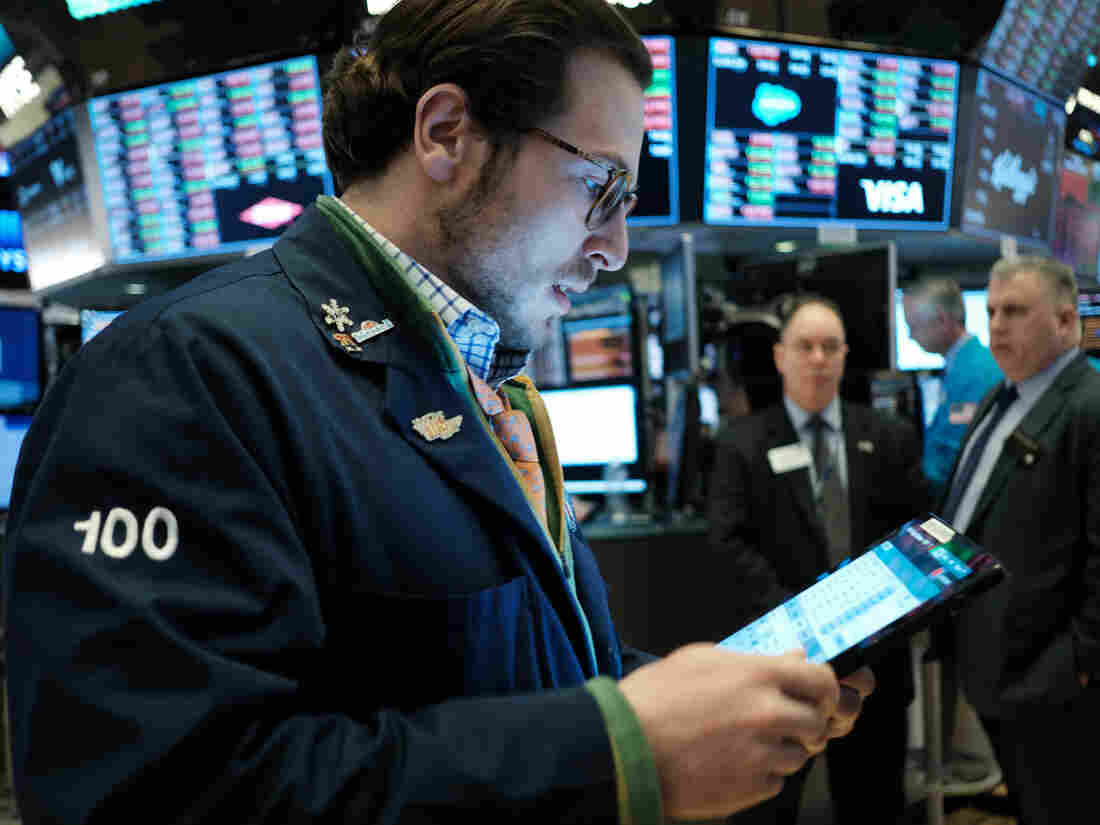 Wall Street swings up and down as volatility retains grip