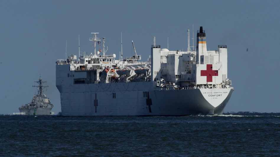 USNS Comfort, seen in 2017, is one of two U.S. Navy hospital ships — along with the USNS Mercy — that are preparing to deploy to assist medical workers expecting to grapple with an influx of patients in the weeks to come. (Alex Wong/Getty Images)