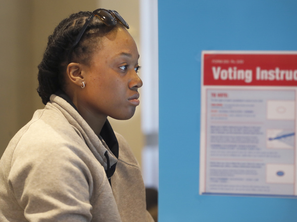 Aadilah Siddeeq votes using an electronic voting machine at a polling place in the Bronzeville neighborhood of Chicago in the Illinois primary.