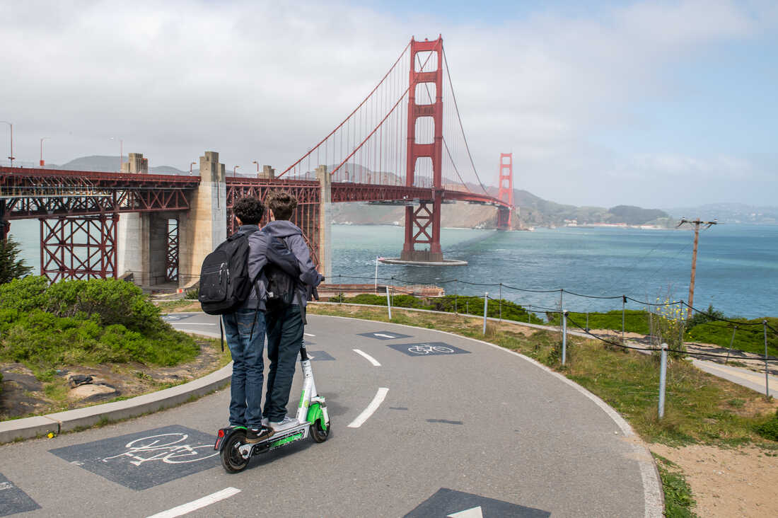 Two children ride a scooter near the Golden Gate Bridge, which is largely devoid of foot traffic. A shelter-in-place order was instituted for San Francisco Bay area residents on Mar. 16th.