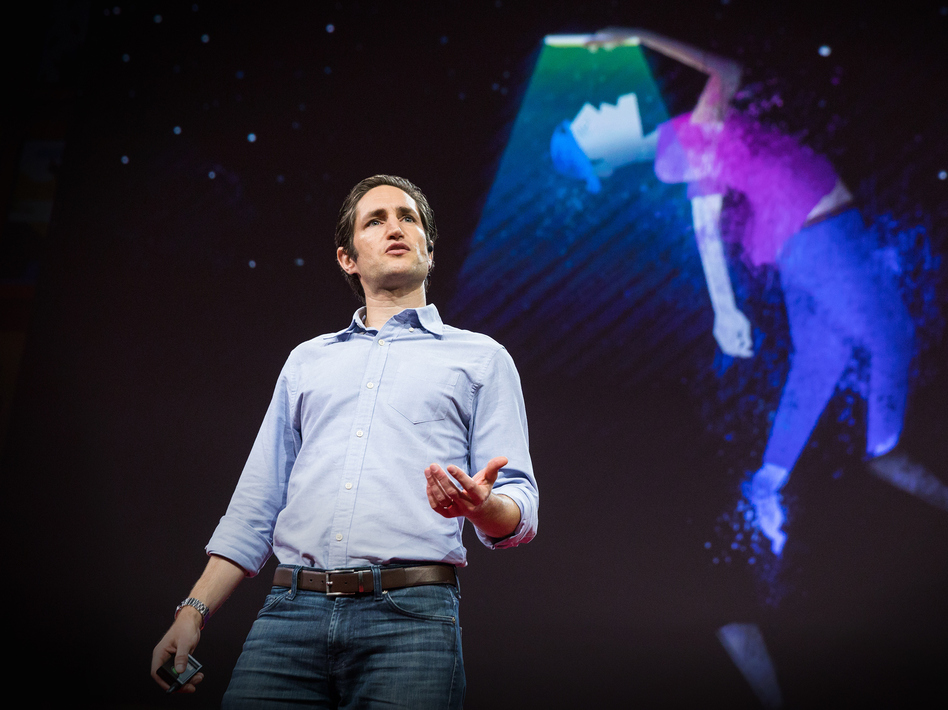 Adam Alter on the TED stage. (Bret Hartman/Bret Hartman / TED)