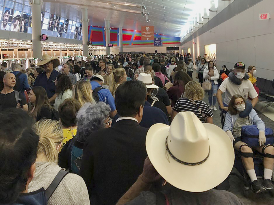 People waited in line to go through the customs at Dallas/Fort Worth International Airport on Saturday as staff took extra precautions to guard against the coronavirus. (Austin Boschen/AP)