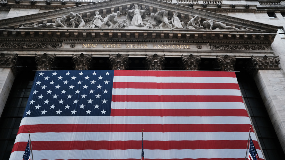 Stocks fell again Monday as U.S. lawmakers continued to work on a massive stimulus measure. The floor of the New York Stock Exchange was closed as the exchange shifted to all-electronic trading amid the coronavirus outbreak. (Spencer Platt/Getty Images)