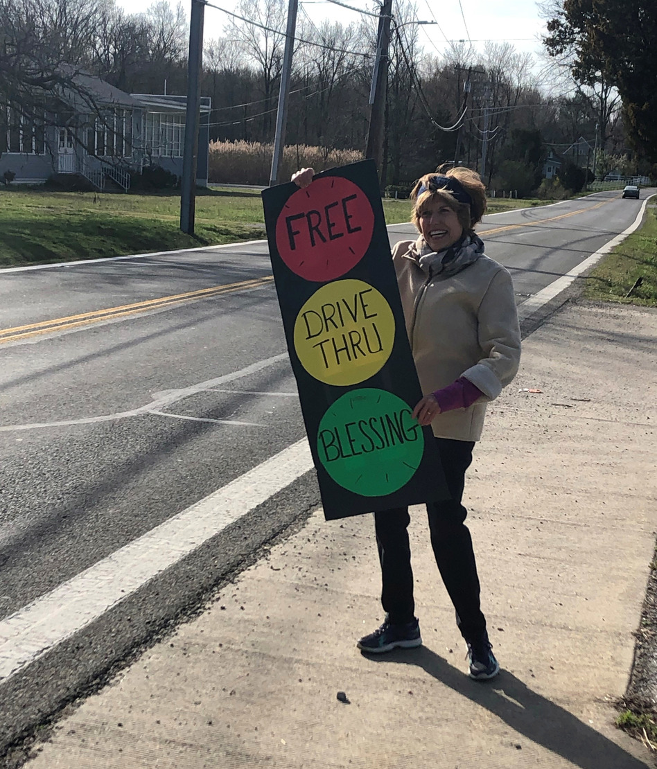 Carol Day, a lay volunteer at Centenary Methodist Church in Shady Side, Md., invites passers by to stop for a blessing. (Tom Gjelten/NPR)