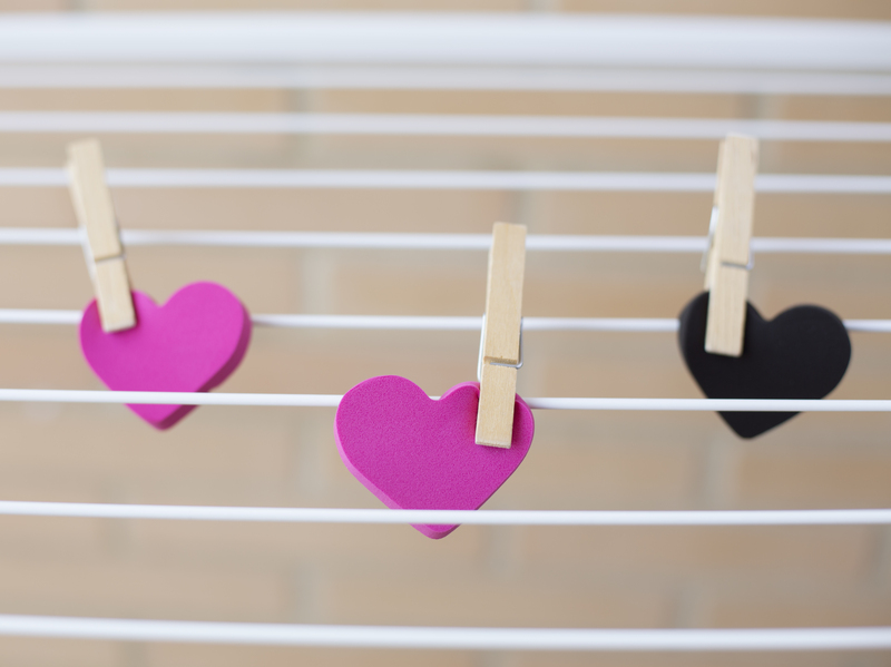three hearts held on clothes pins