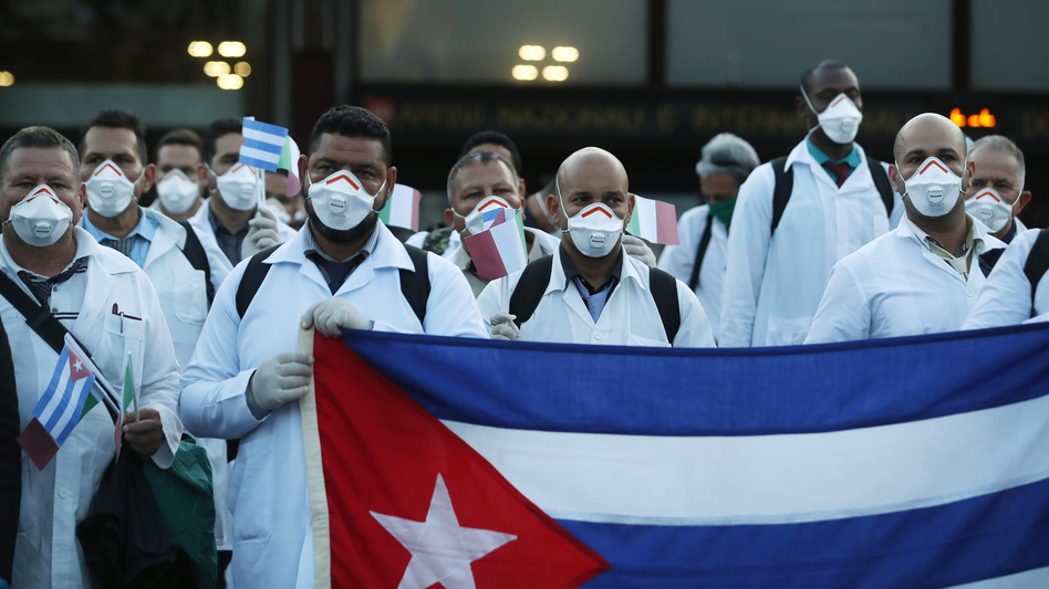 More than 50 doctors and paramedics arrived in Milan from Cuba on March 22 to help with coronavirus treatment. (Antonio Calanni/AP)