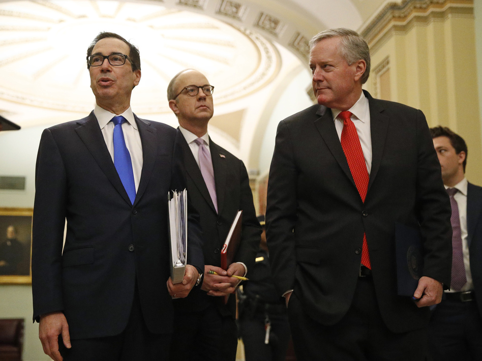 Incoming White House chief of staff Mark Meadows (right) walks with Treasury Secretary Steven Mnuchin and  White House Legislative Affairs Director Eric Ueland on Capitol Hill on Tuesday. (Patrick Semansky/AP)