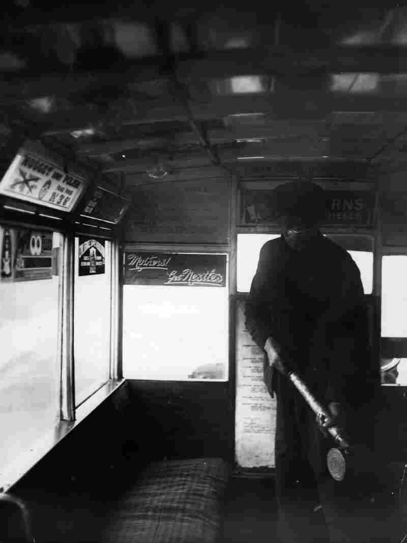 A man sprays the inside of a London bus with disinfectant during the flu pandemic of 1918.