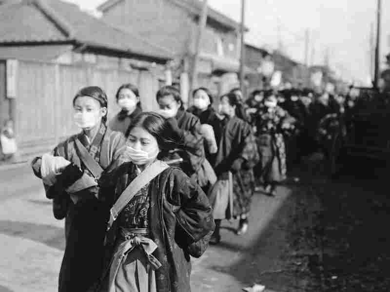 Japanese schoolgirls wear protective masks to guard against the 1918 flu.